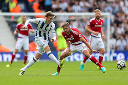 Sam Field of West Bromwich Albion is challenged by Gaston Ramirez of Middlesbrough - Rogan Thomson/JMP - 28/08/2016 - FOOTBALL - The Hawthornes - West Bromwich, England - West Bromwich Albion v Middlesbrough - Premier League.