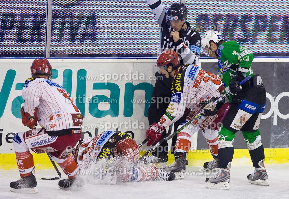 Johannes Reichel and Raphael Hundertpfund of KAC vs Matej Hocevar of Tilia Olimpija at ice-hockey match in 33rd Round of EBEL league between HDD Tilia Olimpija Ljubljana and EC KAC, Klagenfurt, on December 18, 2009, in Arena Tivoli, Ljubljana, Slovenia. Olimpija defeated KAC 4:2. (Photo by Vid Ponikvar / Sportida)