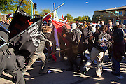 30 NOVEMBER 2011 - PHOENIX, AZ:    Phoenix police battle with anti-ALEC protesters in front of the Westin Kierland Resort and Spa Wednesday. Police pepper sprayed the crowd several times and arrested six or seven people during the melee. About 300 people picketed the American Legislative Exchange Council (ALEC) conference at the Westin Kierland Resort and Spa in Phoenix, AZ, Wednesday. The protesters claim ALEC, a conservative think tank, violates its tax exempt status by engaging in lobbying, a charge ALEC officials deny. Many conservative pieces of legislation, like Arizona's anti-immigration bill SB1070, originate with ALEC conferences (SB 1070 originated at an ALEC conference several years ago). Many of the protesters are also members of the Occupy movement.  PHOTO BY JACK KURTZ