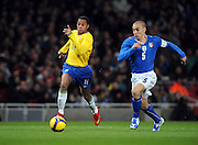 Robinho takes on Fabio Cannavaro of Italy during the International Friendly match between Brazil and Italy at the Emirates Stadium on February 10, 2009 in London, England.