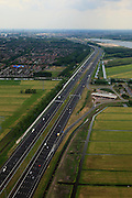 Nederland, Utrecht, Maarssen, 03-05-2011; Rijksweg A2 ter hoogte van Maarssen met zicht op de wijk Maarssenbroek en de verzorgingsplaats met tankstation De Hucht..Motorway A2 with filling station (central Netherlands) ..luchtfoto (toeslag); aerial photo (additional fee required).foto Siebe Swart / photo Siebe Swart