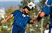 UBC Thunderbird Kerman Pannu heads the ball during Men's U Sports Soccer action at UBC Okanagan on Oct. 20, 2018. It was the first homecoming game for the university. (Marissa Tiel/ Kelowna Capital News)