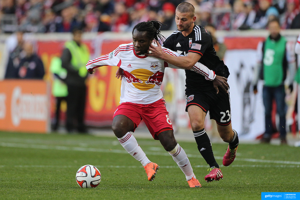 Pegguy Luyindula, (left), New York Red Bulls, is challenged by Perry Kitchen, DC United, during the New York Red Bulls V DC United, MLS Cup Playoffs, Eastern Conference Semifinals first leg at Red Bull Arena, Harrison, New Jersey. USA. 2nd November 2014. Photo Tim Clayton