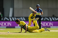 Ashton Agar of Australia (left) fields his bowling during the 3rd One Day International match at Old Trafford Cricket Ground, Stretford<br /> Picture by Andy Kearns/Focus Images Ltd 0781 864 4264<br /> 08/09/2015