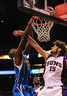 Mar. 14 2010; Phoenix, AZ, USA; New Orleans Hornets center Emeka Okafor (50) puts up a shot against Phoenix Suns center Robin Lopez (15) in the first half at the US Airways Center. Mandatory Credit: Jennifer Stewart-US PRESSWIRE.