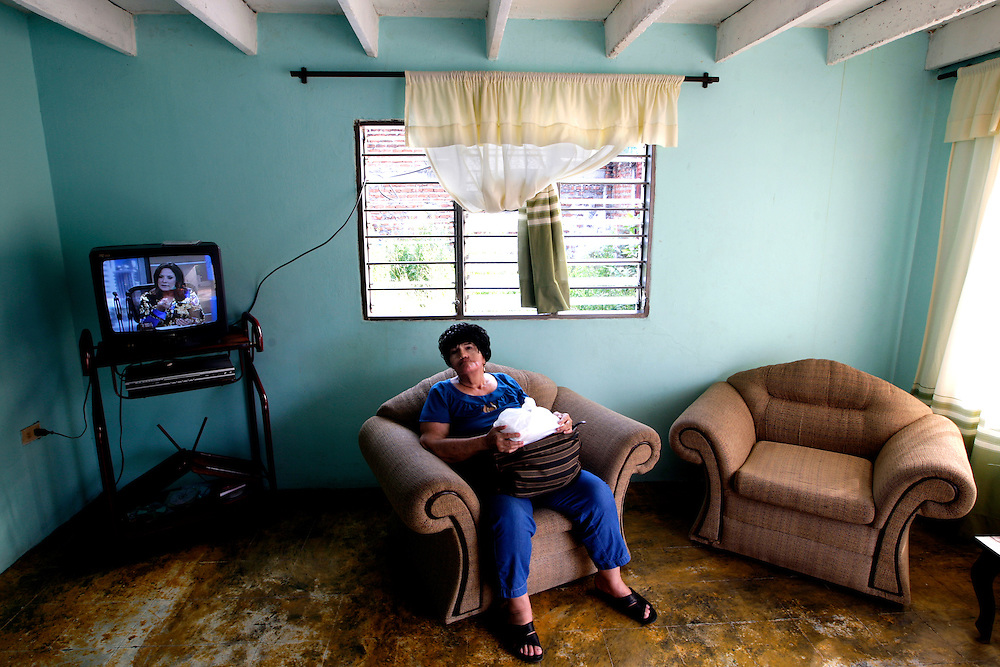 Back in Colombia Amalia Mendoza sits in a empty room at her mother's home in Valledupar. Her attitude has changed, she now is confident to be in public and shades of her former self have returned. Greg Kahn/Staff