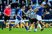 Ayoze Perez (#17) of Newcastle United tries to hold onto possession of the ball under pressure from Dominic Calvert-Lewin (#29) of Everton and Lucas Digne (#12) of Everton during the Premier League match between Newcastle United and Everton at St. James's Park, Newcastle, England on 9 March 2019.