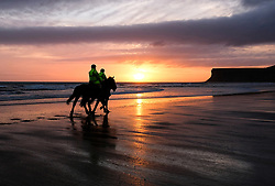 © Licensed to London News Pictures. <br /> 05/04/2017<br /> Saltburn-by-the-Sea, UK. <br />  <br /> Two riders and their horses go for a morning ride out as the sun begins to rise over the beach at Saltburn-by-the-Sea in North Yorkshire.<br /> <br /> Photo credit: Ian Forsyth/LNP
