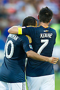 FRISCO, TX - AUGUST 11:  Landon Donovan #10 of the Los Angeles Galaxy celebrates after scoring a goal with teammate Robbie Keane #7 against FC Dallas on August 11, 2013 at FC Dallas Stadium in Frisco, Texas.  (Photo by Cooper Neill/Getty Images) *** Local Caption *** Landon Donovan; Robbie Keane