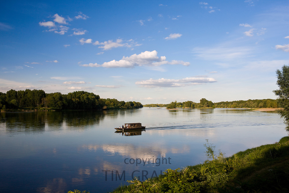 Wooden motor boat on the River Loire at Candes St Martin, Loire Valley, France