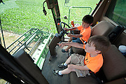 Holden Miller, 5, and his cousin, Willem Fuller, 4, pretend to drive a large John Deere combine tractor during the fourth annual International Student Farm Outing at the Schultz Family Farm in Cottage Grove, Wis., on June 24, 2012. Co-sponsored by the Schultz family and the University of Wisconsin-Madison International Student Services (ISS), the event introduced more than 100 UW-Madison international students and their families, and friends of the Schultz family to agricultural life in rural Wisconsin.