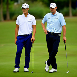 Apr 28, 2016; Avondale, LA, USA; Danny Lee (left) and Steve Stricker (right) wait on the 17th hole during the first round of the 2016 Zurich Classic of New Orleans at TPC Louisiana. Mandatory Credit: Derick E. Hingle-USA TODAY Sports