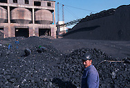 Miners at a regional coal mine sorting coal. 75% of China's growing energy needs come from coal, the cheapest and most polluting form of energy. China is the world's largest producer of coal. Seven of the world's ten most polluted cities are in China, largely due to coal use and the country's dilapidated heavy industries..Dàtóng, Shanxi Province, China. 11/11/2005.Photo © J.B. Russell