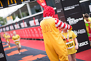 Ronald McDonald awards medals to Ironkids. Saturday. 2013 Ironman Cairns Triathlon Festival. Cairns, Queensland, Australia. 08/06/2013. Photo By Lucas Wroe