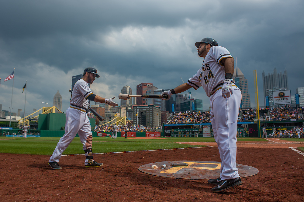 PITTSBURGH, PA - JUNE 08: Pedro Alvarez #24 of the Pittsburgh Pirates hands a bat to Russell Martin #55  during the game against the Milwaukee Brewers at PNC Park on June 8, 2014 in Pittsburgh, Pennsylvania. (Photo by Rob Tringali) *** Local Caption *** Pedro Alvarez;Russell Martin