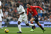 Real Madrid's Lass Diarra (l) and Osasuna's Javad Nekounam (r) during La Liga match.January 18 2009.