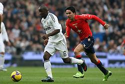 Real Madrid's Lass Diarra (l) and Osasuna's Javad Nekounam (r) during La Liga match.January 18 2009.