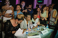 The judging panel take notes as contestants parade in front of them at Istanbul's second Trans Beauty Pageant.
