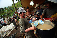 Workers hired by the Colombian government to manually eradicate coca crops are served dinner in their camp after a long day of work, in El Campanario, in a remote area of the southern Colombian state of Nariño, on Thursday, June 21, 2007. (Photo/Scott Dalton)