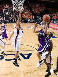 Northwestern guard Jason Okrzesik (1) shoots over Virginia guard Calvin Baker (4).  The Virginia Cavaliers men's basketball team defeated the Northwestern Wildcats 94-52 at John Paul Jones Arena in Charlottesville, VA on November 27, 2007.