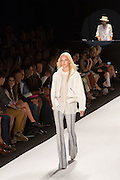 White, gray and blue plaid pants in a loose weave, a white blouse with Peter Pan collar, and a cropped white jacked with zipper details.