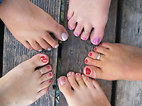 Women's painted toes on the dock.