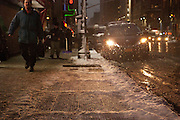 New Yorkers commute through snow during evening rush hour in midtown. Photo by Natalie Fertig/NYCity Photo Wire