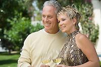 Couple holding wine outdoors