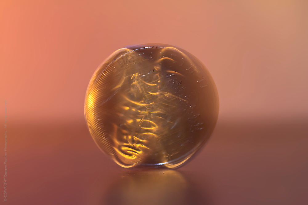 macro photography: motion capture of spinning coin on it's axis