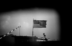 AFGHANISTAN, 13 August 2005...Outside Gardez, towards Khost, an American Flag waves  at the entrance of the USA Army Base.