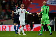 Wayne Rooney of England smiles and opens his arms towards Brad Guzan of USA during the International Friendly match between England and USA at Wembley Stadium, London, England on 15 November 2018.