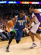 Mar. 16 2010; Phoenix, AZ, USA; Minnesota Timberwolves guard Corey Brewer (22) drives the ball againstPhoenix Suns guard Leandro Barbosa (10) in the first half at the US Airways Center. Mandatory Credit: Jennifer Stewart-US PRESSWIRE.