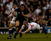 Twickenham. GREAT BRITAIN, Balacks Rico GEAR, breaking leaving Jamie NOON Diving for the tackle, during the, 2006 Investec Challenge, game between, England  and New Zealand [All Blacks], on Sun., 05/11/2006, played at the Twickenham Stadium, England. Photo, Peter Spurrier/Intersport-images].....   [Mandatory Credit, Peter Spurier/ Intersport Images].