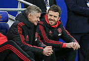Manchester United interim Manager Ole Gunnar Solskjaer and Michael Carrick on the bench smiling during the Premier League match between Cardiff City and Manchester United at the Cardiff City Stadium, Cardiff, Wales on 22 December 2018.