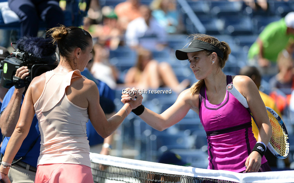 30.08.2014. Flushing Meadows, New York, USA. US Open tennis championships.  R-L, Nicole Gibbs (USA) shakes hands with Flavia Pennetta (ITA)