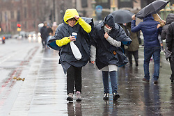 © Licensed to London News Pictures. 03/01/2016. London, UK. People struggle to walk during heavy winds and rain on Westminster Bridge in London.  London and the UK has experienced heavy rain and wind today. Photo credit : Vickie Flores/LNP