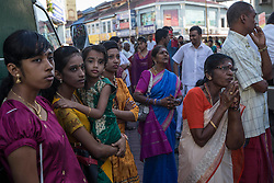 © Licensed to London News Pictures. 23/01/2016 Ipoh, Malaysia. Devotees look on and pray to the chariot carrying the deity Lord Murugan on its way to the Kallumalai Murugan Temple in Ipoh, Malaysia, during the Thaipusam Festival, Saturday, Jan. 23, 2016. Photo credit : Sang Tan/LNP
