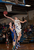 Gilford's Coby Goodwin goes up for the basket guarded by Franklin's Matt Hennessy during Tuesday nights NHIAA varsity basketball at Gilford High School.  (Karen Bobotas/for the Laconia Daily Sun)