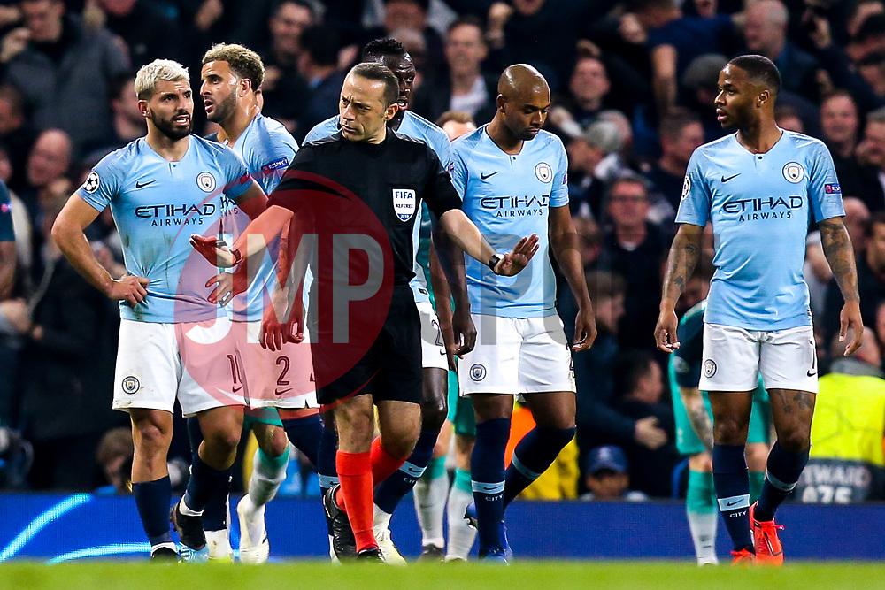 The referee calms Manchester City players as he goes to check a decision on VAR - Mandatory by-line: Robbie Stephenson/JMP - 17/04/2019 - FOOTBALL - Etihad Stadium - Manchester, England - Manchester City v Tottenham Hotspur - UEFA Champions League Quarter Final 2nd Leg