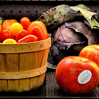 Red, Yellow Tomatoes in Basket Plus Cabbage and Ripe Apples in Saint Paul, Minnesota