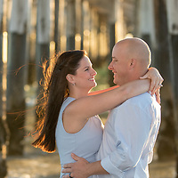 10th Anniversary, Ashtin & Ron, Couple smiling & embracing by pier