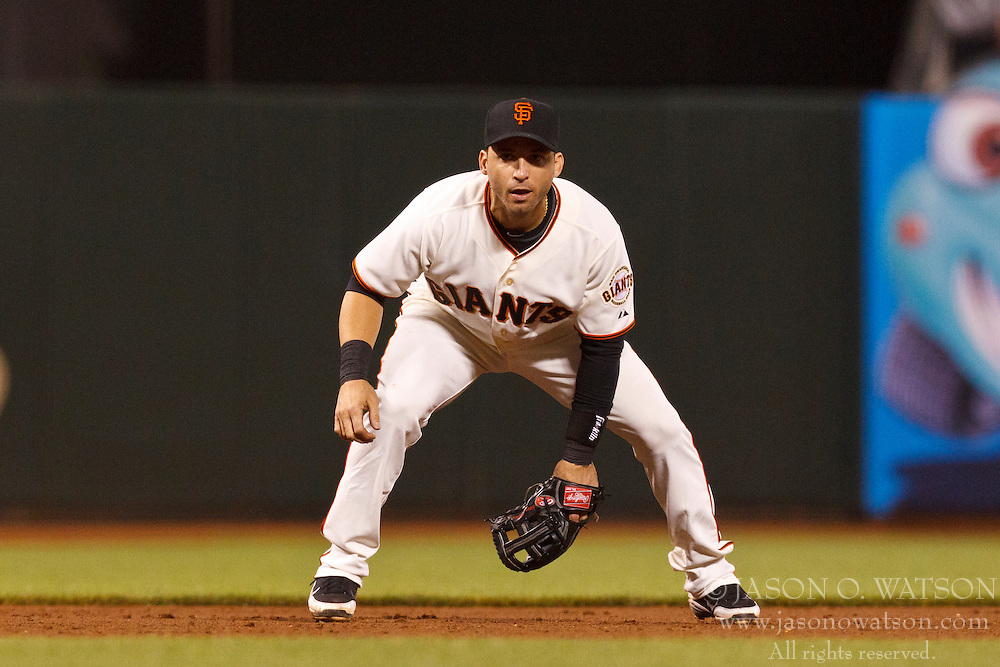 SAN FRANCISCO, CA - JULY 30: Marco Scutaro #19 of the San Francisco Giants stands in the infield during the eighth inning against the New York Mets at AT&T Park on July 30, 2012 in San Francisco, California. The New York Mets defeated the San Francisco Giants 8-7 in 10 innings. (Photo by Jason O. Watson/Getty Images) *** Local Caption *** Marco Scutaro