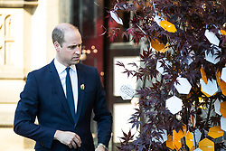 © Licensed to London News Pictures . 22/05/2018 . Manchester , UK . PRINCE WILLIAM leaves Manchester Cathedral and hangs a messages on a Tree of Hope outside the Cathedral , after a Service of Remembrance on the first anniversary of the Manchester Arena bombing . On the evening of 22nd May 2017 , Salman Abedi murdered 22 people and seriously injured dozens more , when he exploded a bomb in the  foyer of the Manchester Arena as concert-goers were leaving an Ariana Grande gig . Photo credit : Joel Goodman/LNP