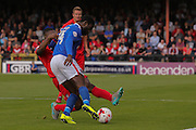 York City defender Femi Illesami tackles Carlisle United forward Jabo Ilbehre during the Sky Bet League 2 match between York City and Carlisle United at Bootham Crescent, York, England on 19 September 2015. Photo by Simon Davies.