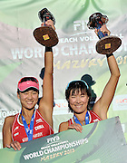 Gold medalists Chen Xue (L) and Xi Zhang (R) from China while medal ceremony during Day 6 of the FIVB World Championships on July 6, 2013 in Stare Jablonki, Poland.