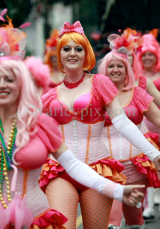 10 February 2013. New Orleans, Louisiana. .Mardi Gras. The Krewe of Thoth, in existence since 1947 parades through Uptown New Orleans. Members of the Pussyfooters dance troupe accompanies Thoth, brightening the streets as they go. .Photo; Charlie Varley.