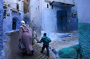 MOROCCO: Chouen..This town in the Rif Mountains is famed for marijuana and its whitewashed narrow streets, tinted green and blue here.