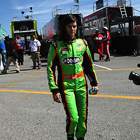 NASCAR Sprint Cup driver Danica Patrick walks from her hauler to the garage area, during a NASCAR Daytona 500 practice session at Daytona International Speedway on Wednesday, February 20, 2013 in Daytona Beach, Florida.  (AP Photo/Alex Menendez)