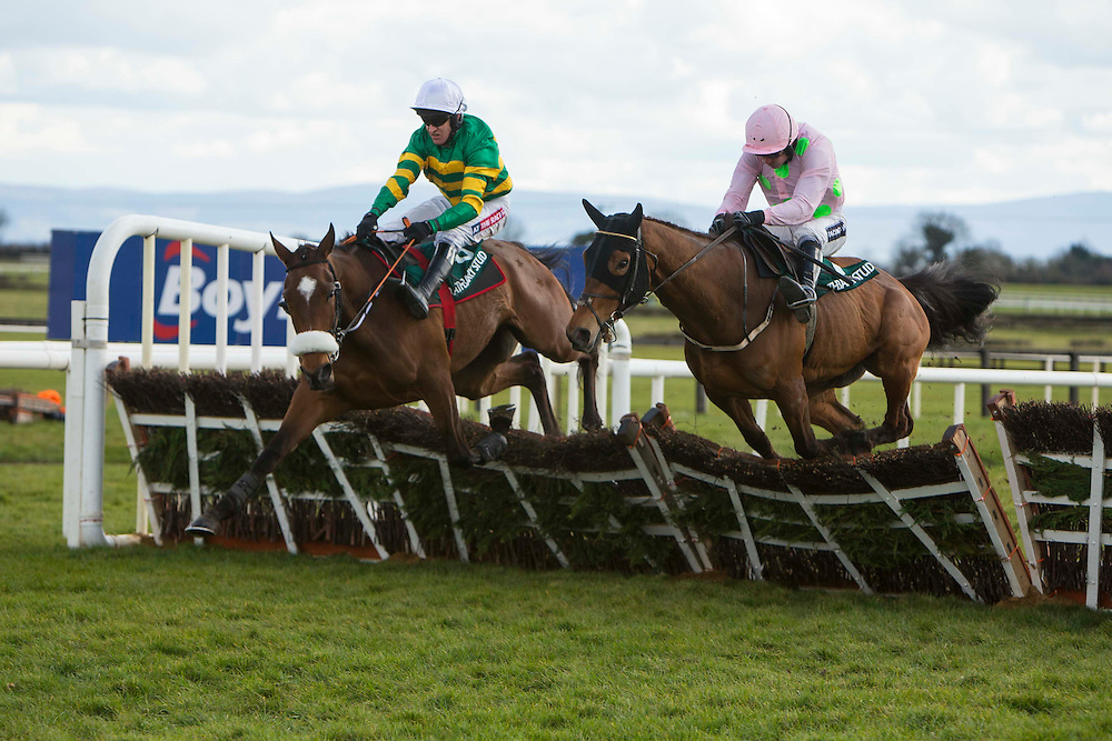 Horse Racing - Fairyhouse Easter Festival, Monday 28th March 2016<br /> Barry Geraghty on G. Elliott trained Sutton Place clears the last to win the Rathbarry & Glenview Studs Novice Hurdle<br /> Photo: David Mullen /www.cyberimages.net / 2016