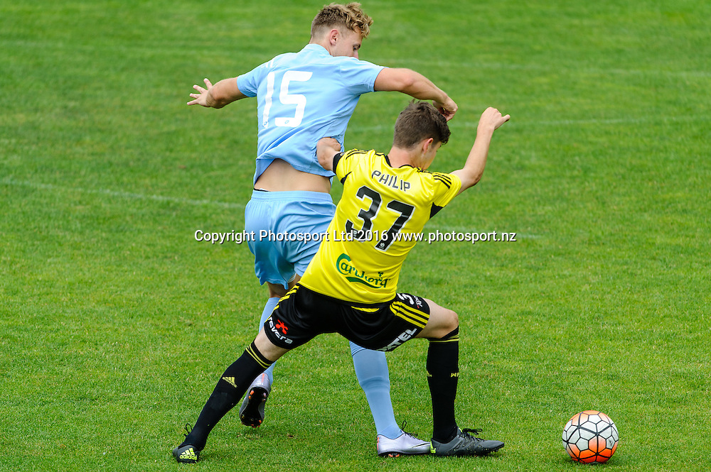 Sam Mason-Smith and Sam Phillip contest for the ball during ASB premiership Wellington Phoenix vs. Hawke's Bay United match at Newtown Park, Wellington, New Zealand. Saturday 6th February  2016. Copyright Photo: Mark Tantrum / www.Photosport.nz
